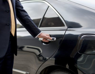 lifestyle concierge opening a car door