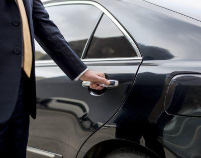 lifestyle concierge opening a car door