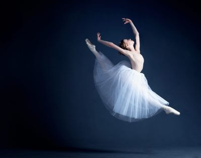 ballerina against a dark background
